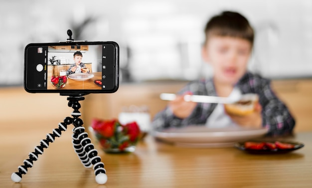 Blurred kid recording himself