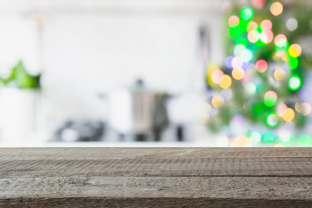 Blurred kitchen with christmas treeon tabletop. background for display your products.