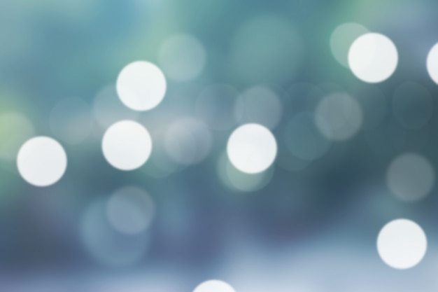 Blurred light green gradient bokeh abstract background