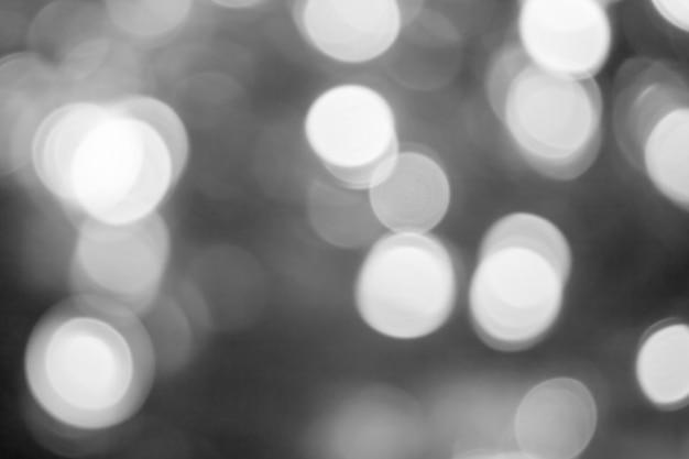 부드러운 빛 빛나는 축제 크리스마스 텍스처와 흐릿한 조명 어두운 회색 배경 추상 보케