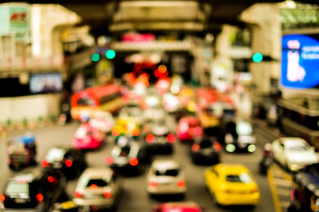 Blurred lines traffic road with town & cars at bangkok, thailand for trave