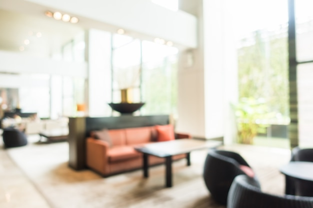 Blurred lobby with a red couch