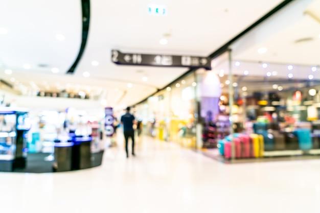 ぼやけた高級ショッピングモールと小売店