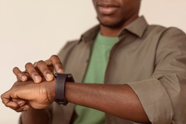 Blurred man checking his smart watch