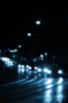 Blurred night scene of traffic on the roadway.