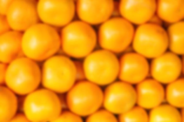アジアの市場でぼやけたオレンジ。観光とレクリエーションの概念