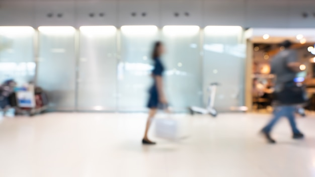 Blurred passengers in airport hall