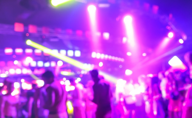 Blurred people dancing at music night festival event