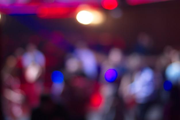 Blurred people dancing in night club