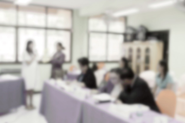 Blurred people negotiation in conventional room