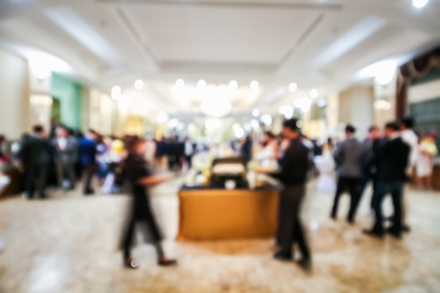 Blurred people in a room at an event