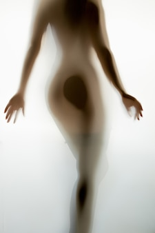 Blurred photo of sexy naked woman from back walking away
