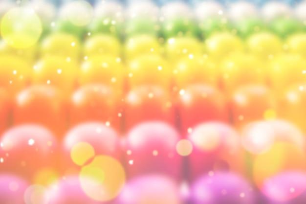 自然なボケ味の光のボールとぼやけた虹の背景。多数のカラフルで明るいお祭りのボケ味を持つ抽象的な大きくぼやけた虹の背景。テキスト用のコピースペースのあるテクスチャ。