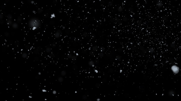 Blurred realistic snow falling on black background