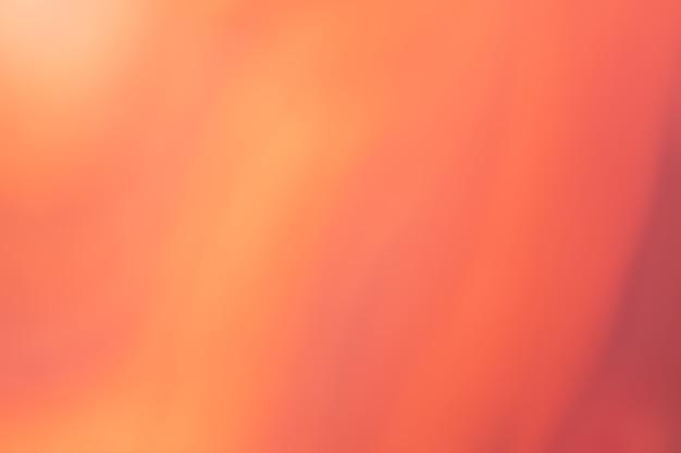 ぼやけた赤とオレンジの背景。ぼけとボケ味のデフォーカスアート抽象的な生姜のグラデーションの背景。