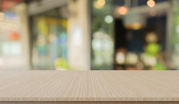 ぼやけたレストランバーカフェ明るい色とウッドデッキの背景