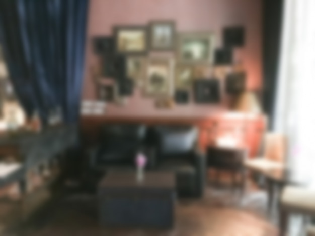 Blurred room with frames on the wall
