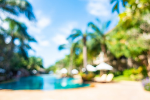 Blurred scene of outdoor swimming pool in hotel resort