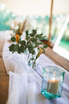 Blurred, selected focus photo of rustic wedding table