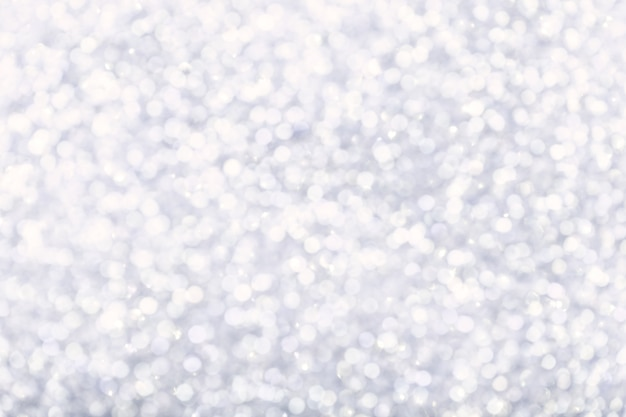 Blurred shiny white background with sparkling lights.