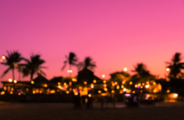 Blurred silhouette sunset beach resort with palm tree