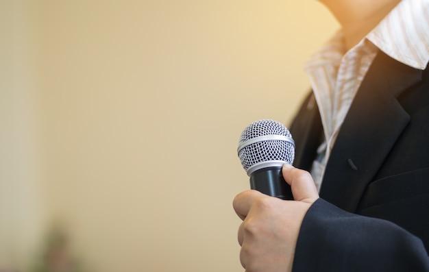 Blurred of smart businesswoman speech, presentation talking with microphone