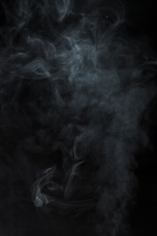 Blurred smoke on black background