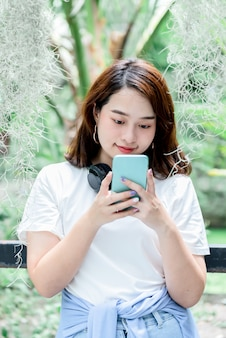 Blurred soft images of asian pretty woman 20 year old, using mobile phone