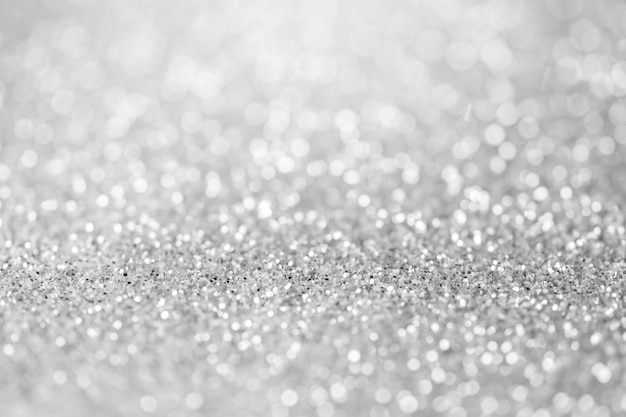 Blurred sparkling silver color glitter light as abstract festive background