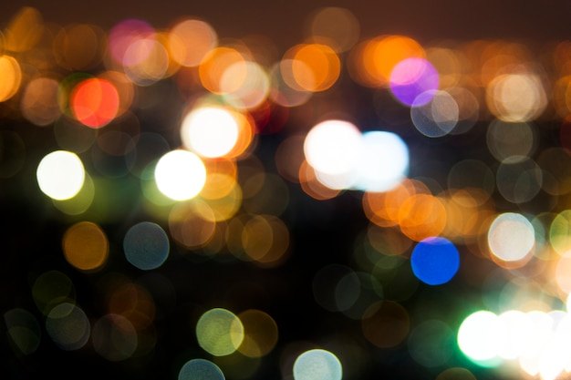 Blurred street bokeh lights at night time