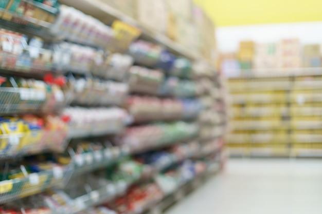 Blurred supermarket snack on shelves at grocery.