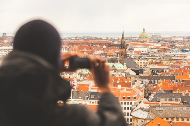 Blurred tourist taking an aerial photo of copenhagen