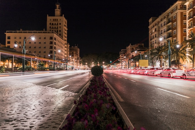 Blurred traffic lights on street at night