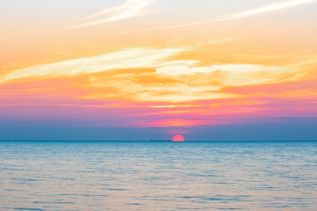 Blurred of tropical colorful sunset over ocean on the beach