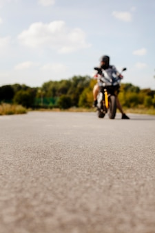 Blurred view of the biker on the road
