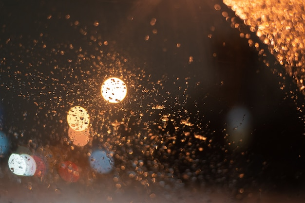 Blurred with raindrops and lights.