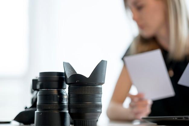 Blurred woman choosing between multiple photos
