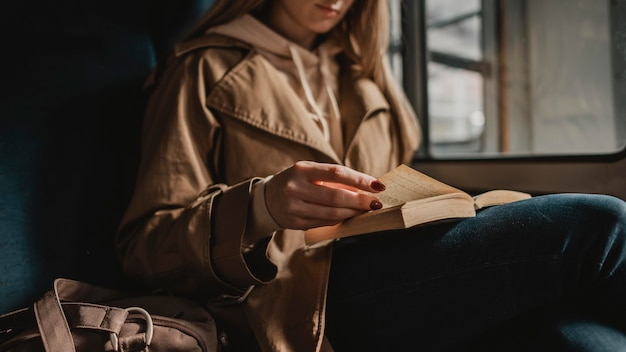 Blurred woman reading a book inside of a train