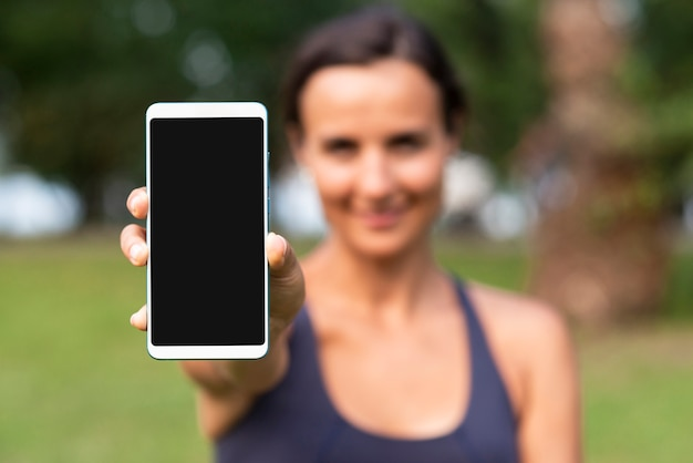 Blurred woman with smartphone mock-up