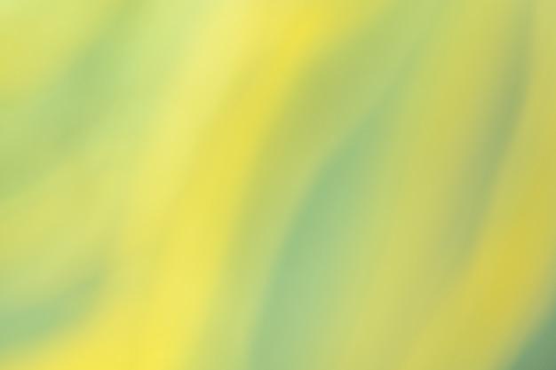 ぼやけた黄色と緑の背景。 d