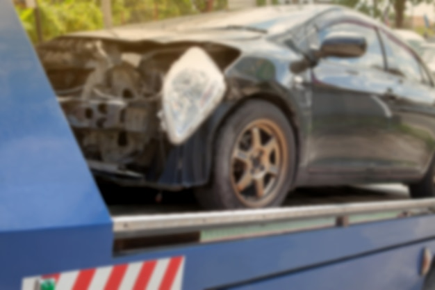 Blurry background of black car on accident on the forklift.