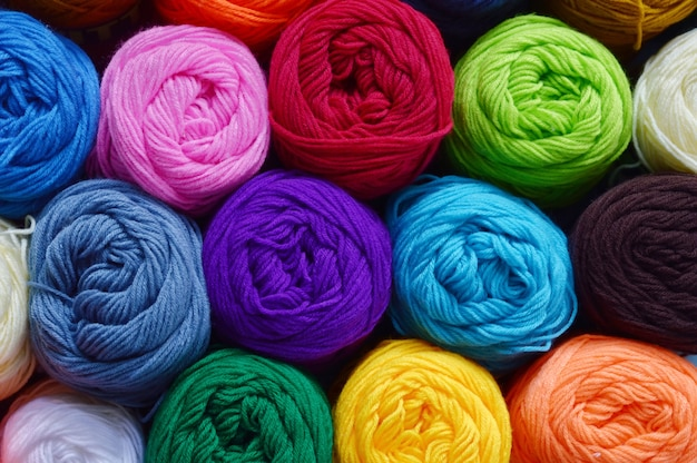 Blurry background of colorful knitting.