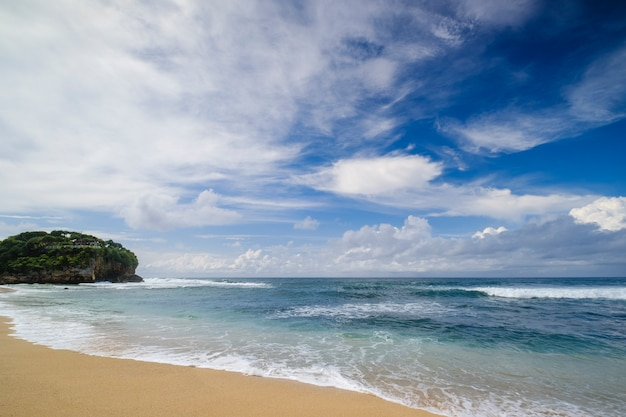 Blurry background of seascape at drini beach with dramatic cloud and sky in the morning