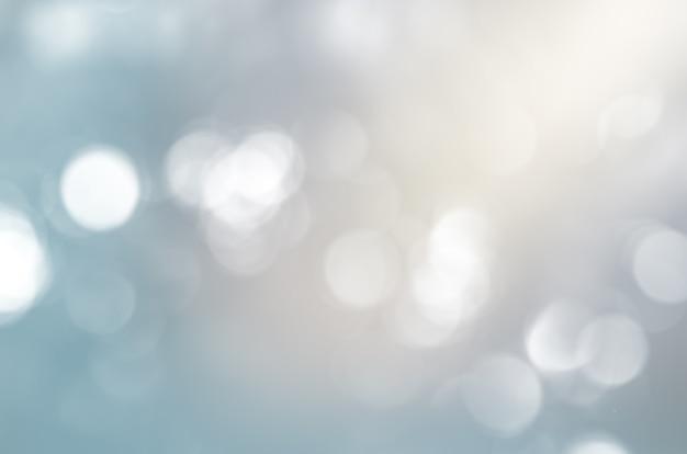 파란색 음영의 둥근 입자가 있는 흐릿한 배경