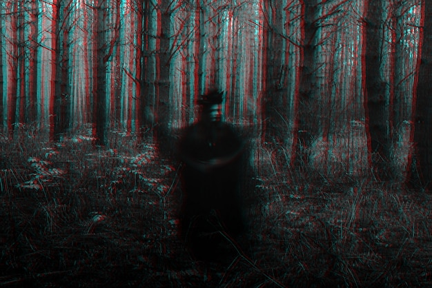 Blurry frightening black silhouette of an evil witch casting spells. black and white with 3d glitch virtual reality effect