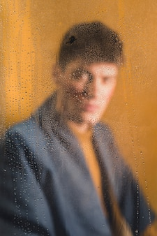 Blurry portrait of man looking at camera