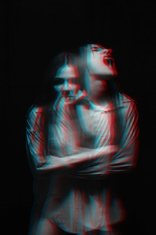 Blurry portrait of a psychopathic girl with mental paranoid disorders. black and white with 3d glitch virtual reality effect