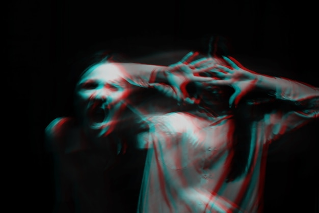 Blurry portrait of a psychopathic girl with schizophrenic mental disorders on a dark background. black and white with 3d glitch virtual reality effect