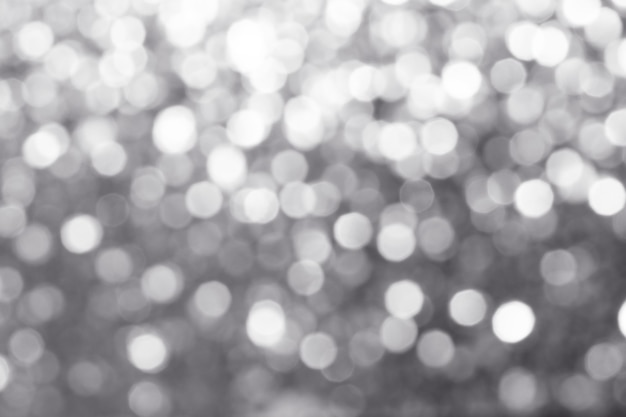 Blurry shiny silver glitter textured background