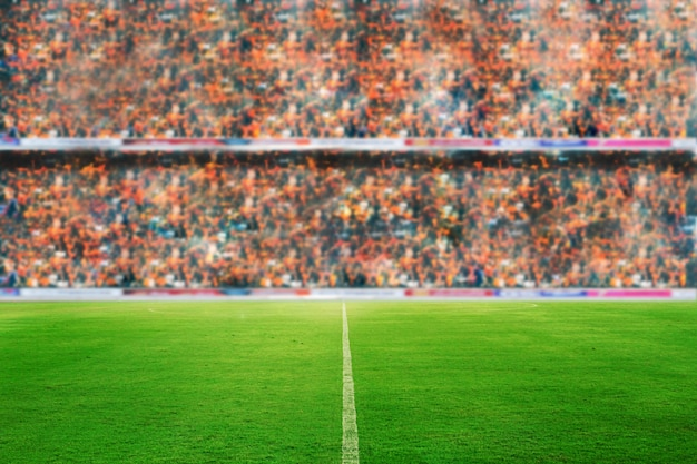 Blurry and soft focus of football stadium and arena soccer field championship win for back